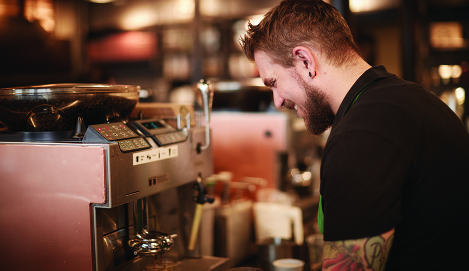 Starbucks Employee making coffee