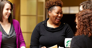 Starbucks Partners working in store