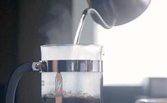 Pour Hot Water Into Coffee Press